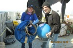 Jerry Prezioso and I carrying the Drifter Buoys out to the deck.