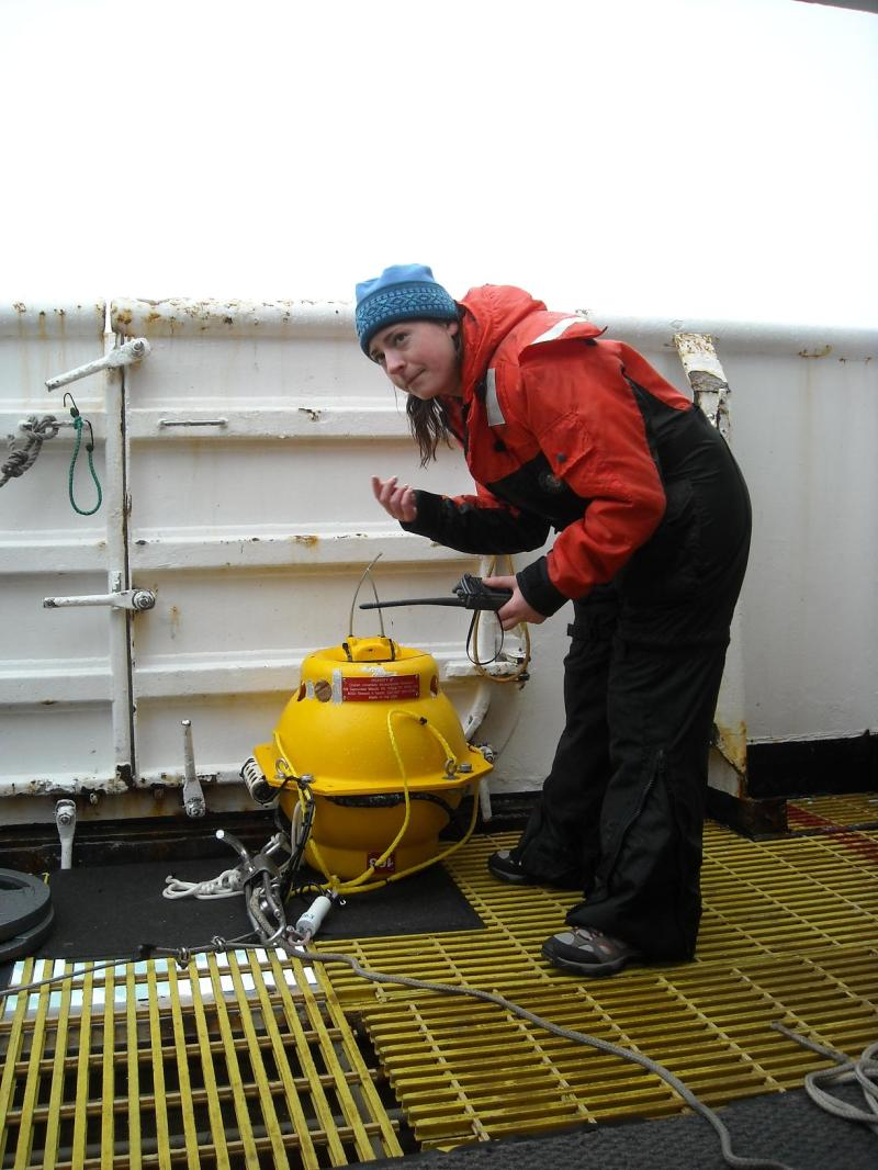 This is Genevieve turning on the satellite tag on the MARU before it goes in the water.