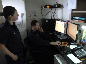 Ensign Ream consults with Lieutenant Russel Quintero, the Field Operations Officer, about the best way to navigate through a narrow passage during her upcoming bridge watch.