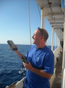 Using photometer to monitor aerosol properties. (photo taken by Mapping Intern Kalina Grabb