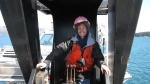 Here I am operating the crane which moves boats up over the ship and over two other levels of boats.