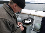 Captain Keith Sternberg swings the compass as we pass by the San Juan Islands.