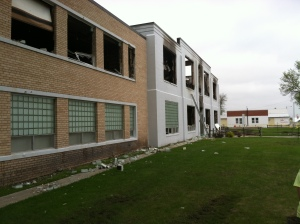 Aftermath of a fire early Sunday morning that destroyed most of the high school.  Credit Jill Cody for the photo