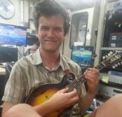 Robin playing his mandolin