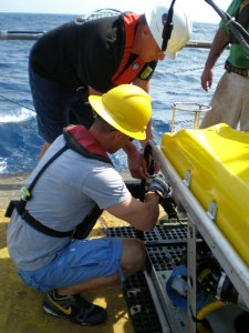 JB attaching the CTD probe to the ROV with instructions from Steve Matthews.