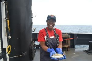 Adria McClain holding a spottail pinfish