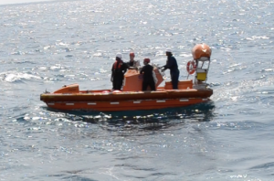 NOAA divers and support crew head to the location of the ghost trap.