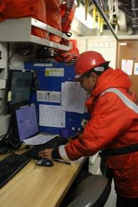 ST Pourmonir checks data on the computer during a CTD deployment.