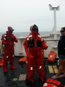 "This is the orange ""Gumby"" suit that will keep you warm in the event of an abandon ship emergency. The safety drills occurred after departure to sea."
