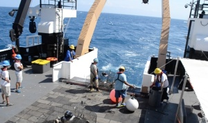 Check out the color of the ocean  while the deck crew wait to deploy the next trap.