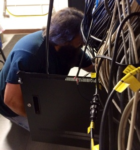 Electronic Technician Mike Peperato quickly restores video feed.