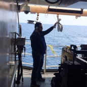 Brian Kinlan uses his cell phone to send video feed of the winch drum. Photo credit Matt Poti.