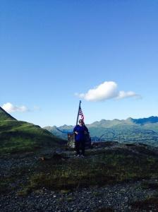 Me, atop Old Woman's Mountain, Kodiak Island, Alaska.  (Courtesy of ENS Micki Ream)