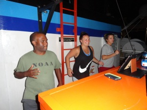 Scientist Andre Debose leading the crew in some exercises