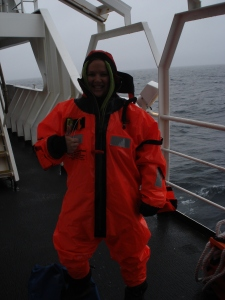 "In my ""Gumby"" Immersion Suit during our Abandon Ship Drill.  This suit is a universal, meaning it can fit people of many sizes, including someone much much taller than me.  Do I look warm?  (Photo courtesy of Vessel Assistant Carl Stedman.)"