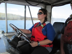 Me, at the wheel of a survey launch.  (Photo courtesy of HST Jackson Barry)