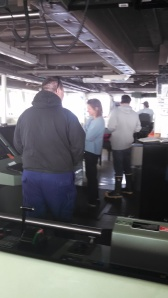 On the Bridge during a trawl - left to right: Lt. Frydrych, Officer on Duty; Taina, Chief Scientist; Allen, Survey Tech; Chief Boatswain Kirk.
