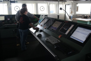 Kacey records data on the Bridge during an AWT.