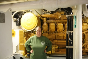 Kacey stands by one of four diesel engines on the Oscar Dyson.