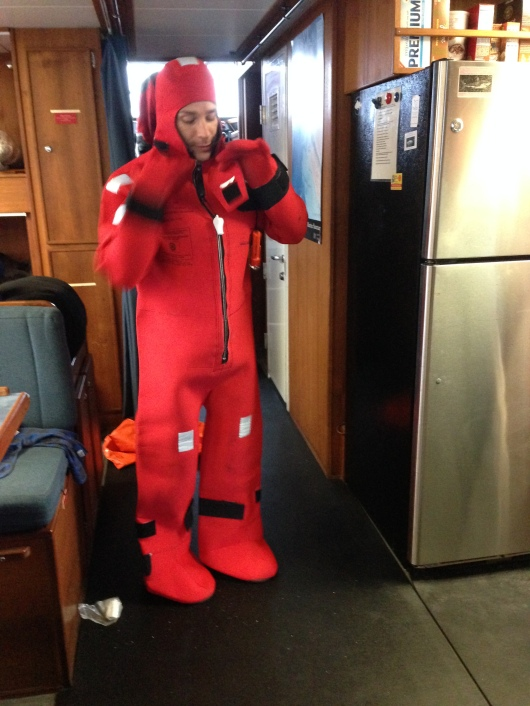 This gumby-looking outfit, called an immersion suit, will keep you afloat and warm if you happen to abandon ship.