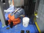 Chief Scientst scrubbing floors.