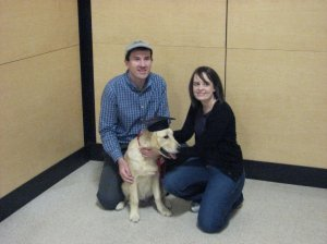 Janelle Harrier-Wilson with husband, Neil, and golden retriever, Devon, as a puppy.