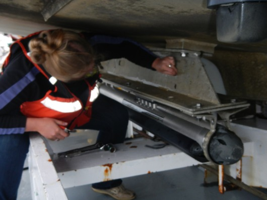 Side scan sonar recording device being removed from the HSL 3101, as the launch was going to be surveying in shallow/rocky waters that could damage the instrument.