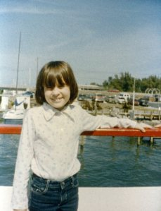 Janelle Harr-er-Wilson on the water in Florida as a child