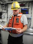 Skilled Fisherman, Steve, enjoys reading about sharks in the dry lab.