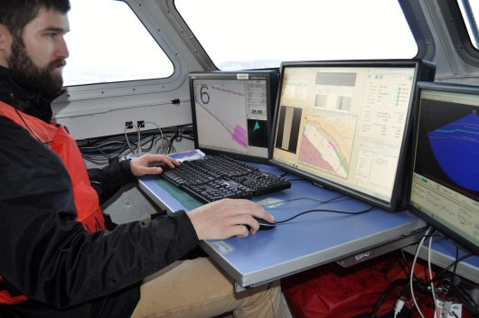 Eli working the sonar equipment.