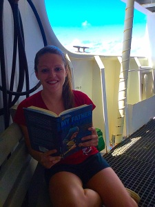 """Chelsea Wegner reading """"My Father, the Captain:  My Life with Jacque Cousteau""""  by Jean Michel Cousteau  in her free time."""