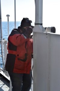 Corey taking photographs for photo-identification of right whales.