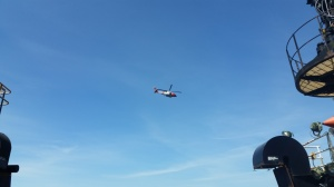 A United States Coast Guard Sikorsky MH-60 Jayhawk flying over the Oscar Dyson