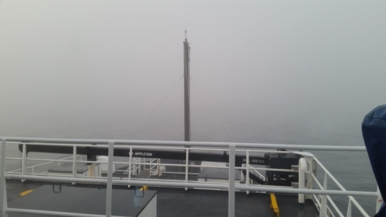 A view from the bridge of the fog. You can barely see past the bow