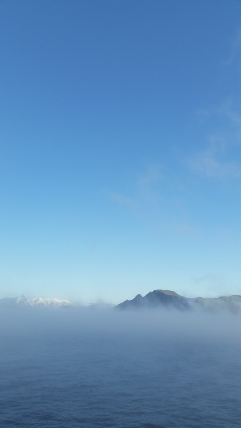 The sky is crystal clear, however the surface is still covered in dense fog