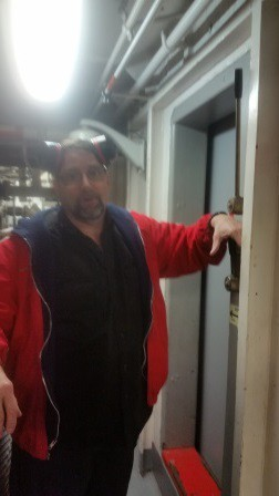 Alan in front of the door showing us the manual bypass