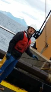 Fisherman Brad Kutyna retrieving an Aleutian Wing Trawl