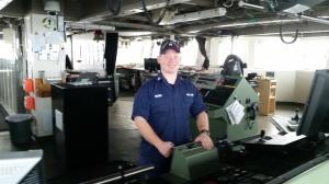 Lieutenant Carl Rhodes on the bridge of the Oscar Dyson