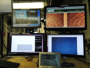 Views of the screens we monitor: from 6 o'clock, moving clockwise:  the winch, altitude monitor, cameras of back deck, sonar of the sea floor and photos being taken as we travel