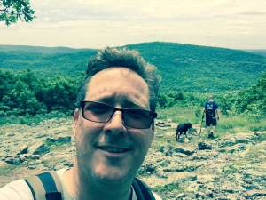 This is a picture of me in the St. Francis Mountains of southeast Missouri doing planning for a student backpacking trip.