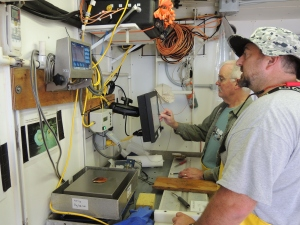 Dr. Scott Gallager and me taking measurements of scallops we caught on a dredge
