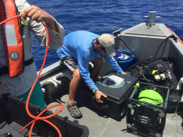 Loading ROV gear into dive boat.