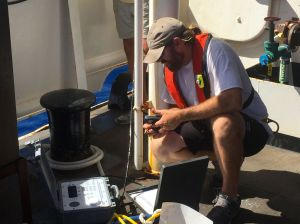 Joel from FWC checks the connection to an acoustic receiver that has just been dropped to the sea floor.