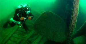 NOAA marine archaeologist diving at the wreck of the USS Montana