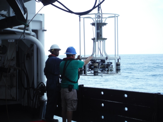 Deckhands assist with lowering the CTD