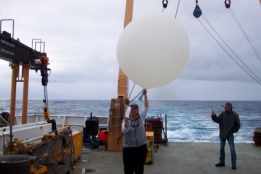TAS Jane Temoshok readies a weather balloon for launch.