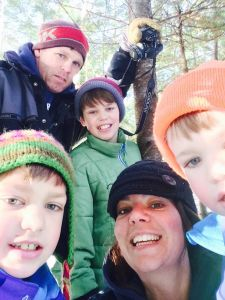 My wife Sarah, myself and our 3 sons cutting a Christmas tree  on our property.