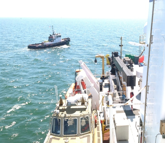 The tugboat arrives to assist the TJ.