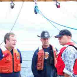 Bob Weller (WHOI), Bosun Bruce Cowden, and Mark Pritchard (WHOI) preparing to pack up equipment.
