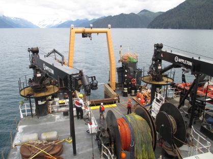 A view of the stern as the deck crew prepares to deploy the AWT. Note the net reel at the bottom of the frame.